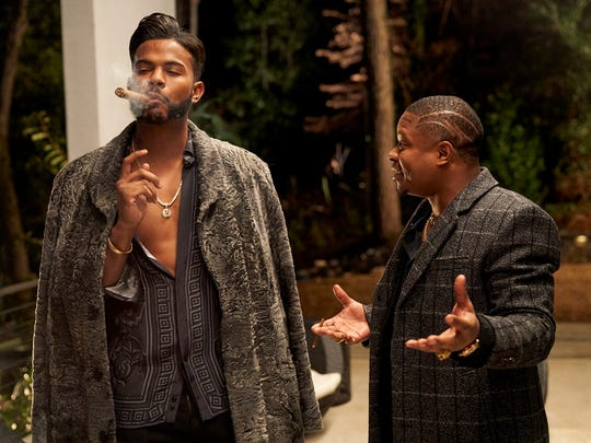 "Trevor Jackson, left, who plays a powerful drug dealer, and Jason Mitchell, his partner, in ""Superfly."""