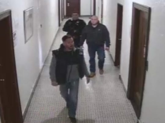In this still image taken from surveillance footage, a group of Hackensack officers walk through an apartment building on Prospect street in December 2016.