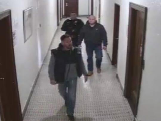 In this still image taken from surveillance footage,