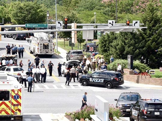 Police respond to a shooting reported at Capital Gazette newspaper in Annapolis, Md.