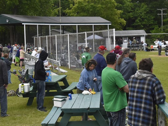 Crowd overflows onto picnic tables and extended seating