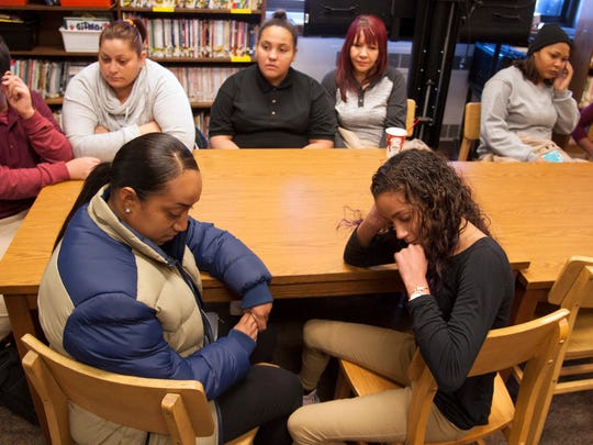 Students from Puerto Rico, who currently attend the Veteran's Memorial School in Camden after being displaced by Hurricane Maria, sit with their mothers in the school's library.    12.13.17