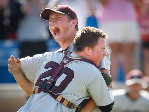 Caravel pitcher Cory Hart and catcher Ryan Zwier embrace as they win the state championship shutting out St. Mark's with a final score of 8-0 to win the 2014 DIAA State Baseball Championship at Frawley Stadium in Wilmington Sunday June 1, 2014.