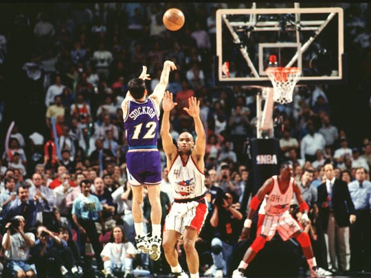 HOUSTON - MAY 29:  John Stockton #12 of the Utah Jazz shoots the game winning shot over Charles Barkley #34 of the Houston Rockets in Game six of the Western Conference Semifinals during the 1997 NBA Playoffs at the Compaq Center on May 29, 1997 in Houston, Texas.  NOTE TO USER: User expressly acknowledges  and agrees that, by downloading and or using this  photograph, User is consenting to the terms and conditions of the Getty Images License Agreement. Mandatory copyright notice: Copyright NBAE 1997  (Photo by Glenn James/NBAE via Getty Images)