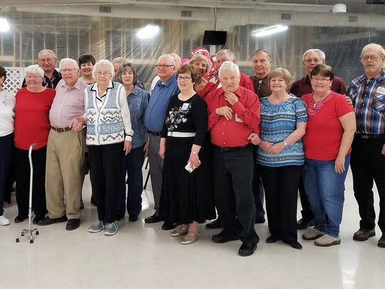 "Square Dancing - Palmer Hanebutt celebrated his 100th birthday on Valentine's day. Making the day even more special is that he and his wife Norma also celebrated their 77th wedding anniversary.  A group of square dancers came today to SWIRCA to help them celebrate.  This couple square danced for over 50 years and Palmer commented ""that square dancing had something to do with living as long as I have!""  In the photo from left are Roger Koester, Linda Lautner, June Gifford, Eldon Fewkes, Palmer Hanebutt, Sherree Fewkes, Norma Hanebutt, Sonny Pfingston, Christine Pfingston, Ron Gifford, Richard Lautner, Darlene Brockriede, Norma Faust, Ron Faust, Bob Brockriede, Kelly Hedges, Judith Reed, Bryant Taylor, Joanne Taylor, Dan Dozier, Mary Dozier and Paul Simpson."