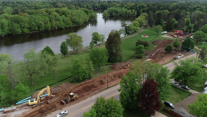 Crews work on the lift station project along the Wisconsin River.