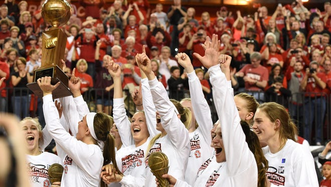 USD celebrates after winning the WNIT championship over FGCU at the DakotaDome Saturday in Vermillion