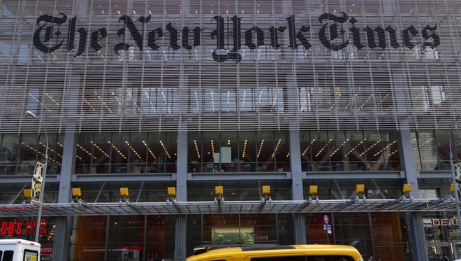 This file photo taken on April 27, 2016 shows the sign on the west side of the New York Times building at 620 Eighth Avenue in New York.