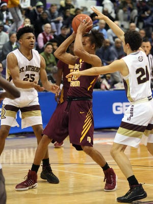 Mount Vernon's Noah Morgan is jammed up between St. Anthony's Ithiel Horton and Alexander Rice during the consolation game of the SNY Invitational at the CCNY's Nat Holman Gymnasium in New York, Jan. 28, 2017.