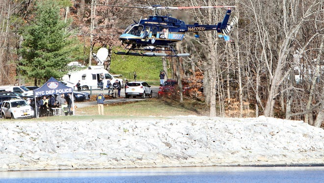 A DEP Police aviation unit conducts a search for a missing plane in Titicus Reservoir in North Salem Nov 20, 2015. The plane was on its way to Danbury Airport when it went missing.