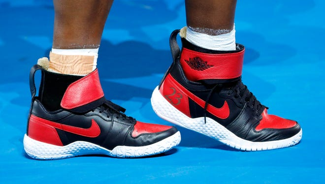 epa05756505 The shoes of Serena Williams of the USA are numbered '23' during her women's final against her sister Venus Williams at the Australian Open Grand Slam tennis tournament in Melbourne, Victoria, Australia, 28 January 2017.  EPA/MADE NAGI
