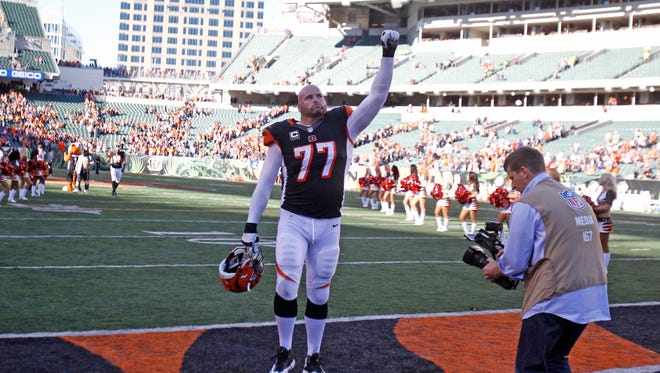 Cincinnati Bengals tackle Andrew Whitworth (77) celebrates with fans following the Cincinnati Bengals win over the Baltimore Ravens during at Paul Brown Stadium in Cincinnati Ohio Sunday October 26, 2014.  The Enquirer/Gary Landers