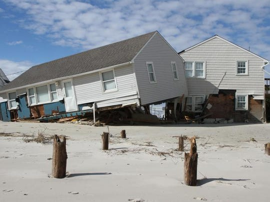 A house that was washed off its pilings and crashed