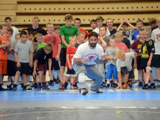 Bill Zadick leads campers through warm-up drills at the beginning of the Zadick Brothers Wrestling Camp in his hometown of Great Falls, Montana.