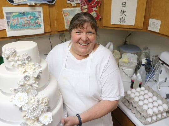 Jo West with Jo's Custom Cakes and Catering stands in her shop in Smyrna Wednesday. West has been in buisness for 11 years.