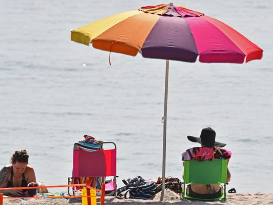 Record-setting temperatures kept it warm for Brevard County on Monday.