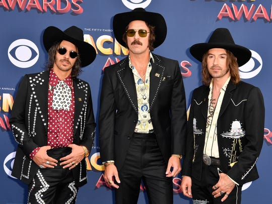 Cameron Duddy, from left, Mark Wystrach and Jess Carson of Midland take to the red carpet for Sunday's ACM Awards in Las Vegas.