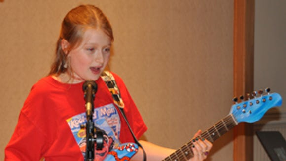 Zazie at a School of Rock camp rehearsal