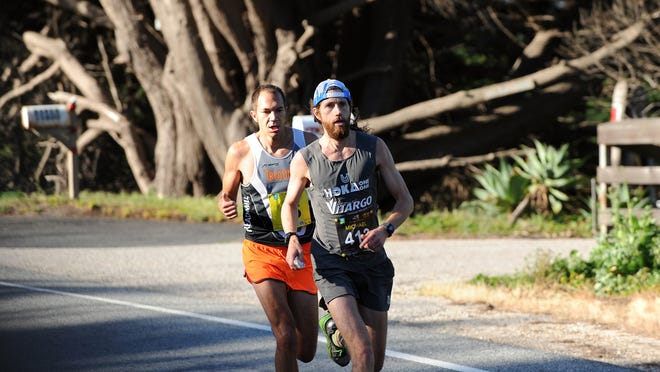 Michael Wardian, front, and Adam Roach ran close together until the last few miles of the 2015 Big Sur International Marathon on Sunday.
