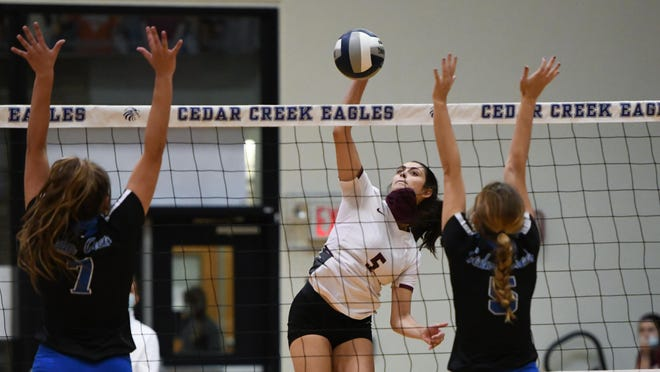Bastrop's Crystal Creek hits the ball over the net in a previous game.
