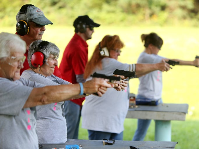 """Members of the 'Women Armed and Ready' gun club take target practice at the Laughery Valley Fish and Game Shooting Range in Versailles. The new club was started by Konnie Couch and Robin Willoughby in May. Giving instruction are Dale Reatherford, owner of Whitewater Valley Firearms Training and part-time Springdale police officer, left, and Brandon Vornauf, one of the firearms trainers. Barb Maness, 75, second from left, uses a Ruger LCP .380. She has her Indiana concealed-carry license and is getting her Florida concealed-carry license to allow her to carry in additional states. She said she wanted to learn to shoot for safety reasons after her husband passed away three years ago. She lives in rural Indiana. She said, """"I've been shooting for about two years. I'm surprised at how accurate I am."""""""