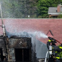 Burlington firefighters battle a blaze atop the old Burlington Free Press building in downtown on Monday, May 23, 2016.