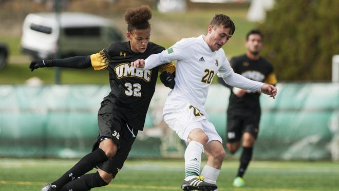 UMBC's Cormac Noael (32) battles for the ball with Vermont's Shane Haley (20) during the men's soccer game between the UMBC Retrievers and the Vermont Catamounts at Virtue Field on Wednesday afternoon.