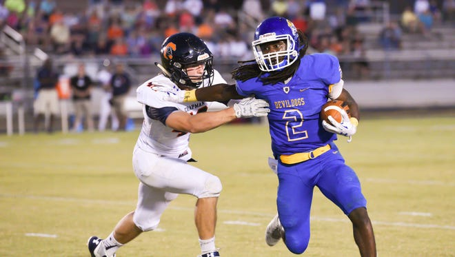 Travelers Rest running back Xavier Terry (2), who rushed for 1,780 yards as a senior, has signed with Palmetto Prep Academy.