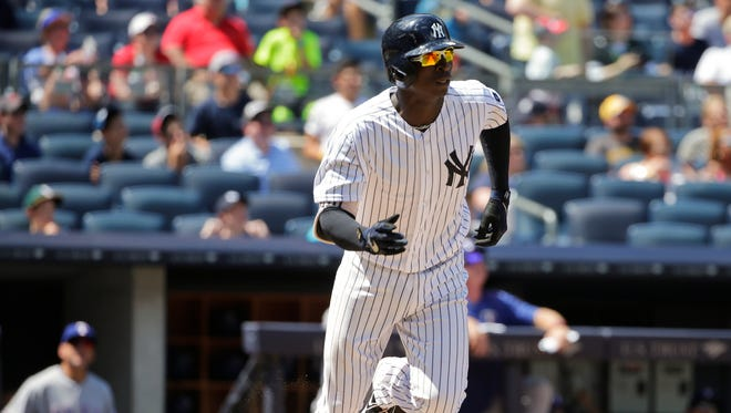 New York Yankees' Didi Gregorius tosses his bat after hitting a home run during the fifth inning of a baseball game against the Texas Rangers Thursday, June 30, 2016, in New York.