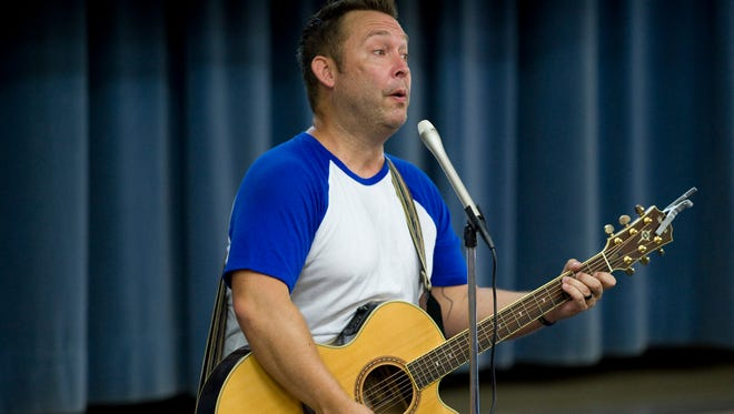 """Matt Hart of Evansville performs Imagine Dragons' """"Radioactive"""" for the students at Stringtown Elementary School as part of his """"reACT to Bullying"""" show last week."""