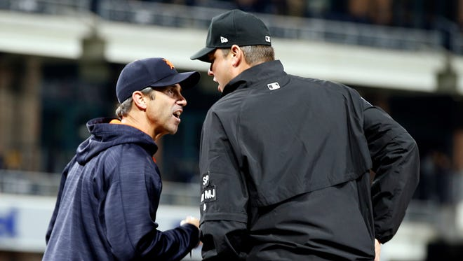 Detroit Tigers manager Brad Ausmus, left, argues with first base umpire Jordan Baker, who called Ian Kinsler out on a swinging strike during the eighth inning Friday night. Ausmus was ejected.