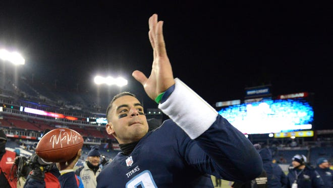 Titans quarterback Marcus Mariota (8) throws an autographed ball to the fans in the stands after the team's playoff-clinching win over the Jaguars at Nissan Stadium Sunday, Dec. 31, 2017 in Nashville, Tenn.