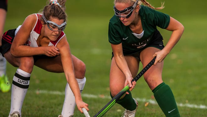Rice's Lisa McNamara chases down the ball during their field hockey OT thriller against Champlain Valley in Hinesburg last week in the regular-season finale. CVU won in overtime, 3-2.