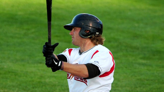Volcanoes outfielder Shilo McCall follows through on a swing against Vancouver during opening night at Volcanoes Stadium, on Thursday, June 18, 2015, in Keizer, Ore.