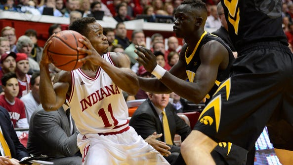 Iowa's Peter Jok, right, defends against Indiana guard