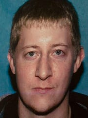 This undated photo provided by the Coeur d'Alene Police Department via the The Spokesman-Review shows Kyle Andrew Odom.