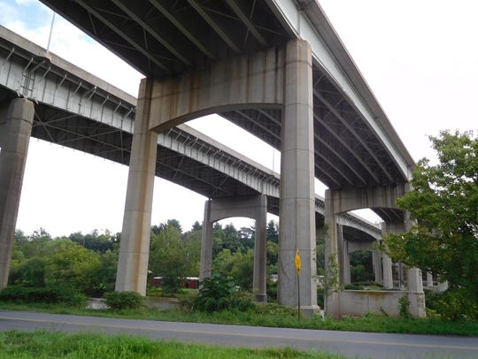 The twin spans of Bowen Bridge loom over Emma Road just west of downtown in 2016.