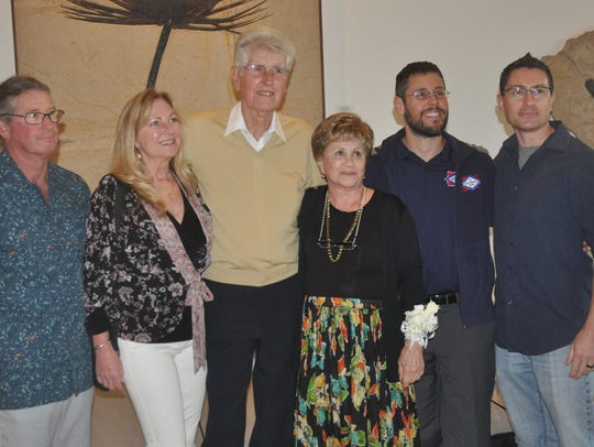 Frank Maggio poses with his wife, Emily, his sons,