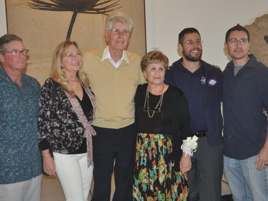 Frank Maggio poses with his wife, Emily, his sons, daughter-in-law and grandson at his retirement party Wednesday night. Maggio, 80, retired from Conditioned Air after 46 years of service.