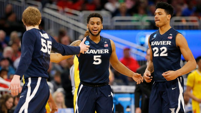 Xavier Musketeers guard J.P. Macura (55), guard Trevon Bluiett (5) and Xavier Musketeers forward Kaiser Gates (22) celebrate after a drive in the second half of the NCAA Tournament First Round game between the Maryland Terrapins and the Xavier Musketeers at the Amway Center in Orlando, Fla., on Thursday, March 16, 2017. Xavier pulled ahead for a 76-65 win over Maryland, advancing to the Round of 32.