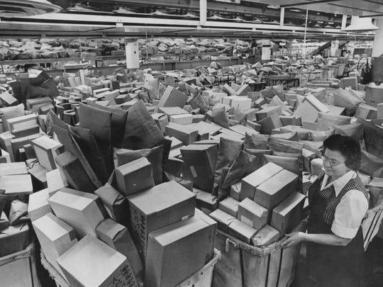 Indianapolis post office employee Dorsie Betner surveys