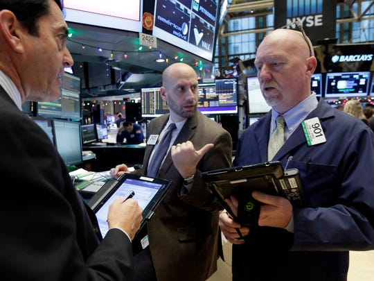 Traders work at the post of specialist Meric Greenbaum, center, on the floor of the New York Stock Exchange, Friday, Dec. 4, 2015. Stocks are posting solid gains Friday morning after the U.S. government reported another month of strong job gains. (AP Photo/Richard Drew)