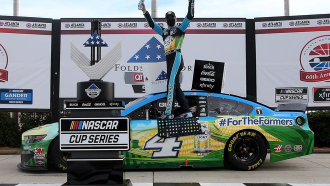 Kevin Harvick, driver of the #4 Busch Light For The Farmers Ford, celebrates in Victory Lane after winning the NASCAR Cup Series Folds of Honor QuikTrip 500 at Atlanta Motor Speedway on Sunday, June 7, 2020 in Hampton, Ga.