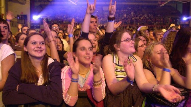 Fans clap as the Counting Crows perform in 2003 in Halenbeck Hall on St. Cloud State University's campus. University officials say don't expect concerts in Halenbeck anytime soon.