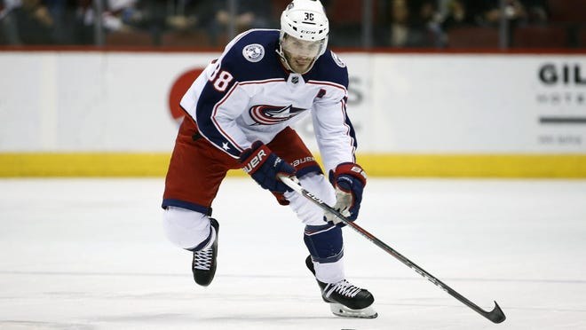 FILE - In this Jan. 25, 2018, file photo, Columbus Blue Jackets center Boone Jenner skates with the puck against the Arizona Coyotes during the first period of an NHL hockey game, in Glendale, Ariz. The Columbus Blue Jackets have signed forward Boone Jenner to a four-year contract extension. The 25-year-old Dorchester, Ontario, native has been a stalwart presence in the emergence of the Blue Jackets as a playoff team in the last two seasons. The contract signed Wednesday, July 4, 2018, locks up Jenner through the 2021-22 season.