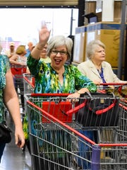 Myra Duhon was one of the first customers in line for the opening of the new Costco in the Ambassador Shopping Center. March 17, 2016.