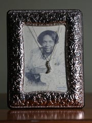 """Stylemaker Shervita West has a photograph of her grandmother Arlea West with a """"journey necklace"""" draped over it in her home as one of her favorite things.May 16, 2016"""