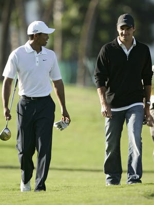 UNITED STATES - MARCH 21:  Tiger Woods and Roger Federer during a practice round at the CA Championship held at the Doral Resort and Spa on the Blue Monster Course in Miami, Florida on Wednesday, March 21, 2007.  (Photo by Sam Greenwood/Getty Images)