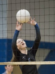 Ellie Bauder (1) sets the ball during the Pensacola High School versus the Washington High School District 1-7A volleyball tournament championship at Washington High School's gymnasium in Pensacola on Thursday, October 20, 2016.
