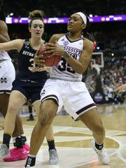Mississippi State's Victoria Vivians (35) fights for